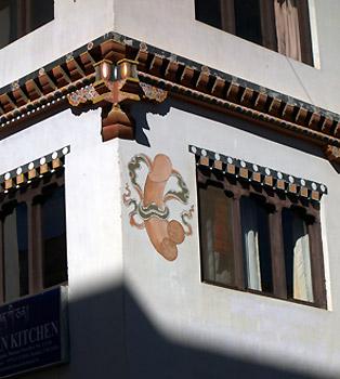 Phallic image on building
