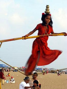 girl on tightrope on Marina Beach, Chennai