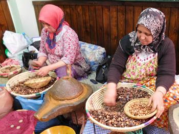 Women extracting argan oil