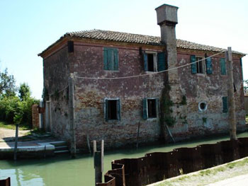 building on canal in Torcello
