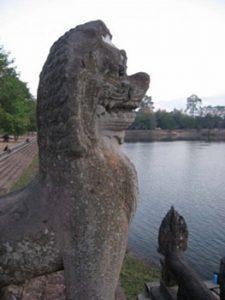 Lion statue near lake