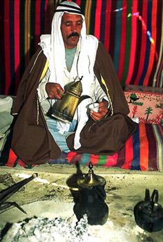 Bedouin man pours tea