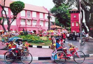 trishaws in Malacca traffic