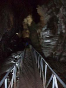 metal bridge into cave