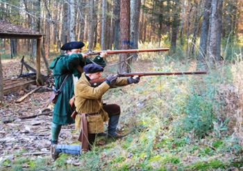 Colonial reenactors showing winter hunting gear