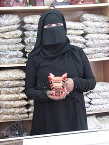 Omani woman in shop