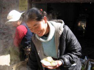 holding Tibetan potato dumplings