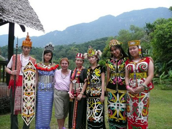 the author with performers in tradional regalia