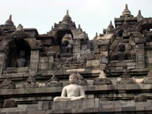 One of many Buddha statues at Borobudur