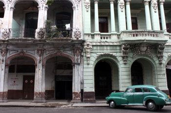 vintage car and historic building in Havana Cuba