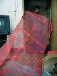 displaying a Jamdani sari