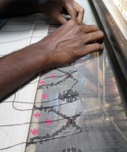 worker making Jamdani saree