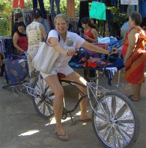 the author on a bicycle in San Patricio Melaque indigenous people's market