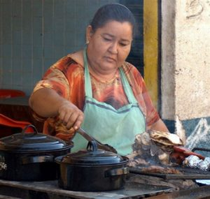 woman cooking in Mexican restaurant