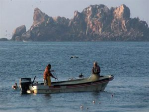 fishermen in a boat in Melaque harbor