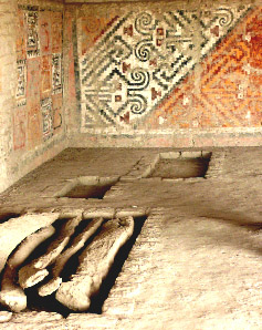 stylized geometric images on wall of tomb