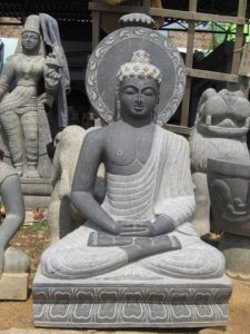 stone carving of Buddha