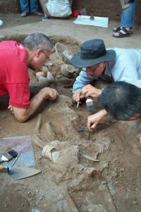 Dr. Charles Higham at archaeological dig
