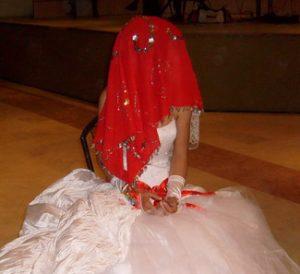 bride wearing red veil