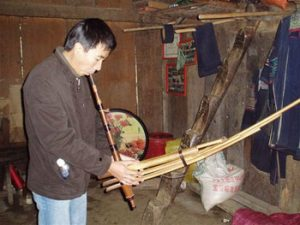 Ting playing ken instrument