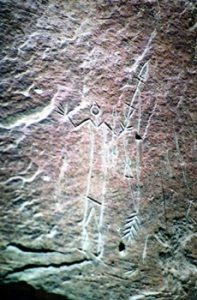 petroclyphs carved into stones at Alberta park