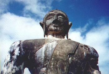 looking up at Buddha statue, Laos