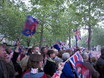 well-wishers waving flags
