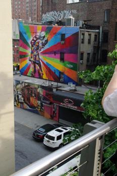 mural on street below walkway