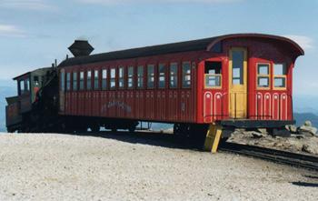 the colorlful passenger railroad car