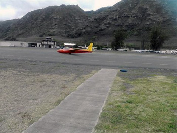 glider plane landing on runway