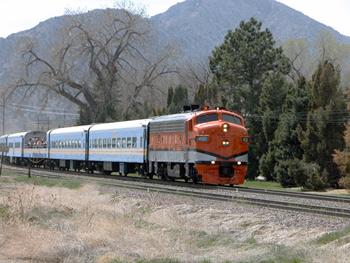 vintage diesel railroad engine pulls train