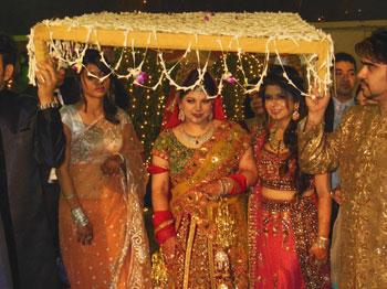 Bride under canopy