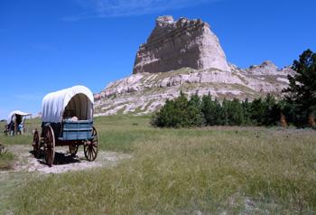 Scotts Bluff with wagon train
