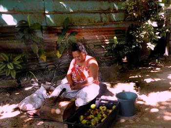 woman husking chestnuts