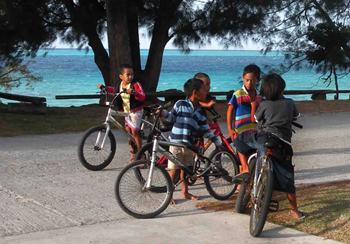 island children on bicycles