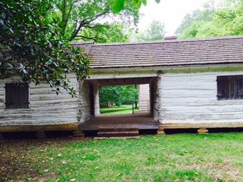 Dog trot log house