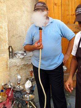 the author's husband, Rick Butler, smoking hookah