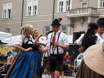 Salzburg locals wearing lederhosen and dirndls