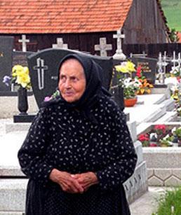 elderly woman in mourning dress
