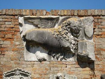 broken frieze of lion, symbol of St. Mark