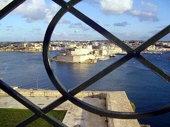 valletta harbour viewed through a window