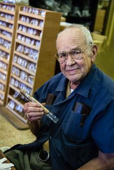 cigar making man