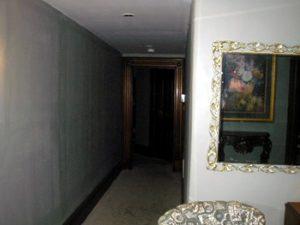 inside a bedroom in Lemp Mansion