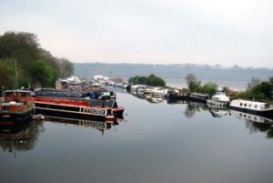 row of moored canal boats