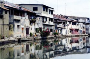 houses line Malacca canal