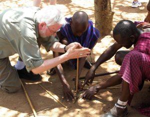 Robert Scheer making fire in Kenya