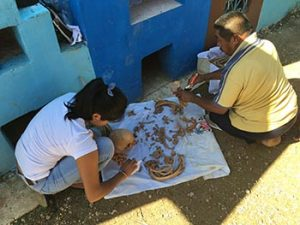dusting bones of ancestors