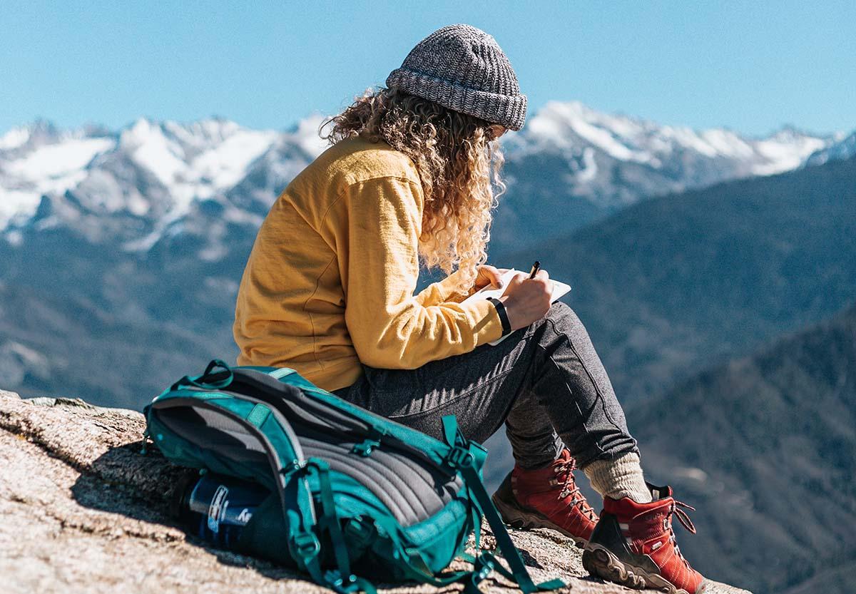 Woman writing travel journal