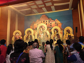 Devotees in front of the Goddess