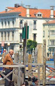 man looking at canal